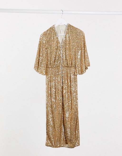 Gouden glitterjurk bruiloftsgasten